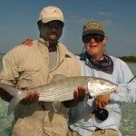 Hermon holding large bonefish with guest