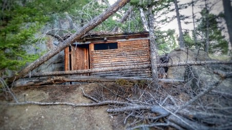 At the end of the trail I see a cabin tucked away in the hillside. Kind of creepy how it is hidden. And at the same time she day.omething I would probably make if I were on my own back in t