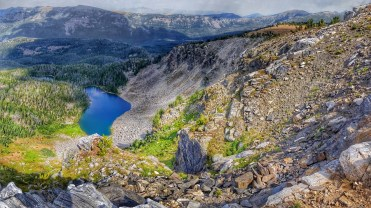 Climbing around the rim of the ridge above the lake