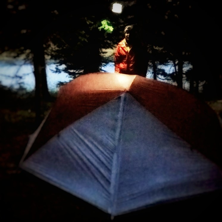 Snuggles getting ready for ... well ... snuggling. Moon on lake in background and our https://mpowerd.com/ serving as our tent lamp.