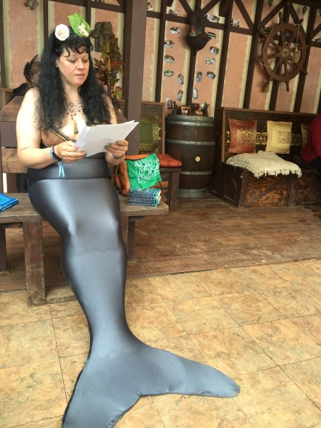 Vaquita mermaid reading The Drowner by Peadar O Guilin