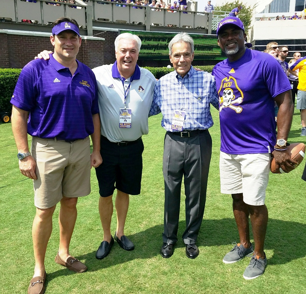 Left to right: Luke Fisher, Brian Bailey, Bill Lewis and Jeff Blake assembled for a photo at the East Carolina-North Carolina State game at Dowdy-Ficklen Stadium on Saturday, Sept. 10, 2016. (Submitted photo)