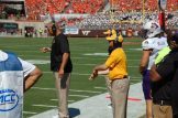 Offensive personnel for the Pirates signal a play. (Photo by Al Myatt)