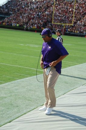 ECU defensive line coach Deke Adams, a former member of the Gamecocks staff, adjusts his shirt on the East sideline on Saturday.