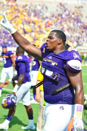 Junior defensive lineman Demage Bailey displays the current total in the Pirates' win column. (WA Myatt photo)
