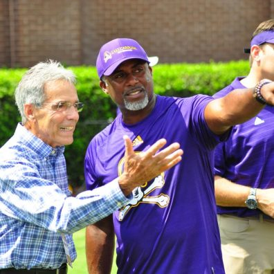 Former East Carolina head coach Bill Lewis (left) winds back the clock to talk strategy with his legendary quarterback, Jeff Blake (middle). Luke Fisher, (right) the subject of perhaps ECU's most iconic image (1992 Peach Bowl game winning touchdown) was also on hand for the 33-30 victory over NCSU.