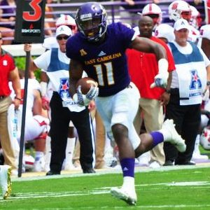 ECU all-purpose player James Summers heads towards one of the two touchdowns he scored last Saturday in the Pirates' win over N.C. State. (Bonesville Staff photo)