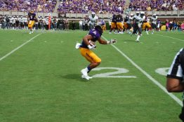 ECU's Quay Johnson looks for running room after a reception on the Pirates' first scoring drive.