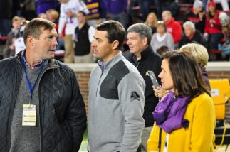 ECU AD Jeff Compher (left) confers with J. Batt, executive director of the Pirate Club.