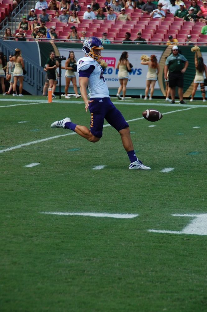 Pirates punter Worth Gregory punts for 42 yards in Saturday's game at USF.