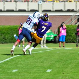 Standout wide receiver Zay Jones hauls in a pass from Philip Nelson despite strong coverage from UCONN defensive back, Jamar Summers. (Bonesville Staff photo)