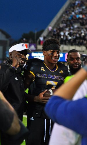 Zay Jones, with head coach Scottie Montgomery (left) and Justin Hardy (right) poses for pictures after being recognized for his record-breaking career during a break in action Saturday afternoon. (W.A. Myatt)