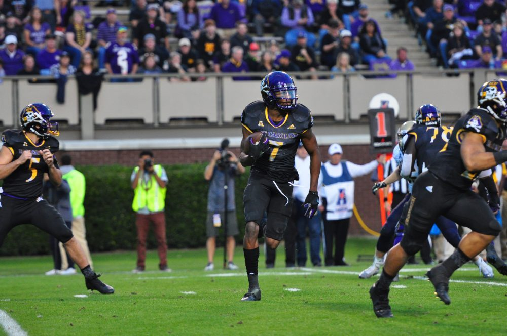 Zay Jones looks for the edge on a shovel pass from quarterback Gardner Minshew. The senior receiver had 212 yards on 12 catches with two touchdowns on his record-breaking night. (W.A. Myatt)
