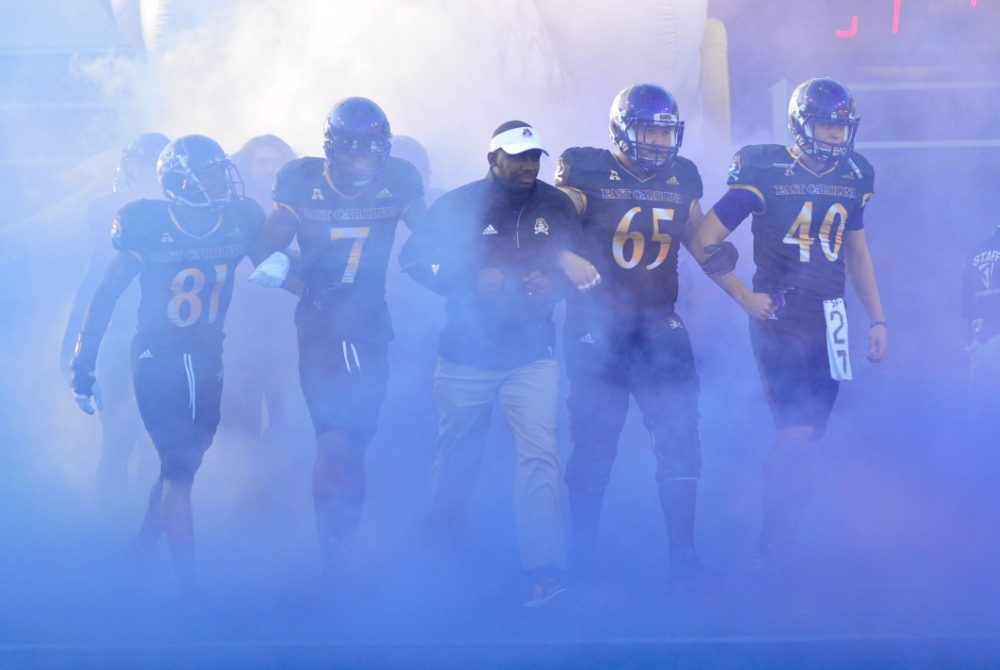 Head coach Scottie Montgomery and the senior class led the Pirates out of the tunnel for the final home game of the 2016 campaign. (Bonesville Staff)