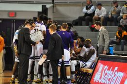 The Pirates huddle before Tuesday's tipoff in Williams Arena at Minges Coliseum. (Al Myatt photo)
