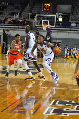 Kentrell Barkley drives off a screen by Deng Riak. (Al Myatt photo)