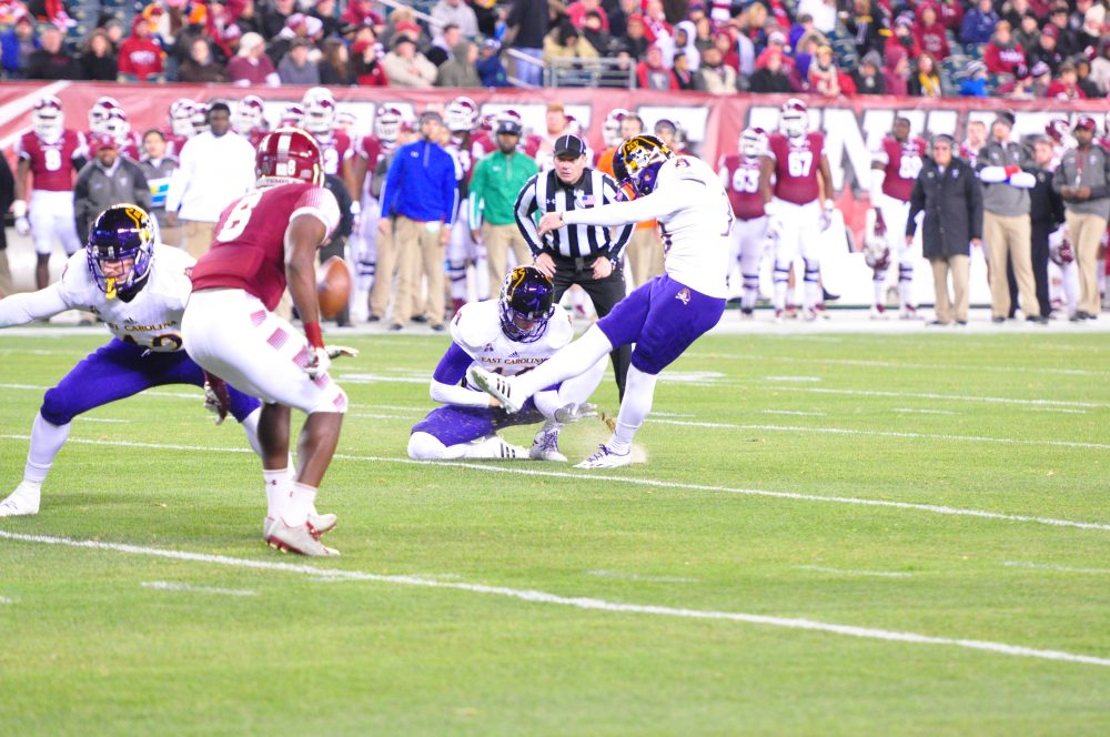 Davis Plowman kicks out of Worth Gregory's hold for a successful conversion and a 7-0 ECU lead. (Al Myatt photo)