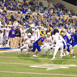 Tulsa's Raymond Taylor is surrounded by ECU's kickoff coverage team.