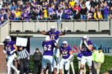 East Carolina offensive lineman Brandon Smith holds James Summers aloft after a touchdown for the Pirates. (W.A. Myatt photo)