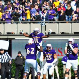 East Carolina offensive lineman Brandon Smith holds James Summers aloft after a touchdown for the Pirates. (Bonesville Staff photo)