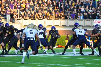 Senior James Summers runs through a big hole in Saturday's American Athletic Conference matchup with Navy. (Bonesville Staff)