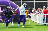 Second year East Carolina head coach Scottie Montgomery leads the Pirates onto the field for the Purple-Gold Spring Game on Saturday, Apr. 22, 2017. (Photo by Bonesville Staff)