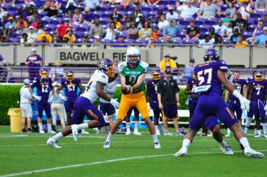 Redshirt freshman quarterback Reid Herring hands the ball off to running back Derrell Scott. (Photo by Bonesville Staff)