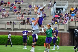 Center Garrett McGhin lifts senior wide receiver Jimmy Williams in the air after a touchdown reception as quarterback Gardner Minshew looks on. (Photo by Bonesville Staff)