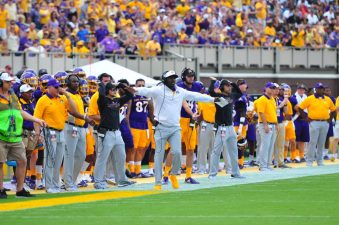 Head coach Scottie Montgomery relays a signal to the field during Saturday afternoon's non-conference contest with Virginia Tech in Dowdy-Ficklen Stadium. (Photo by W.A. Myatt)