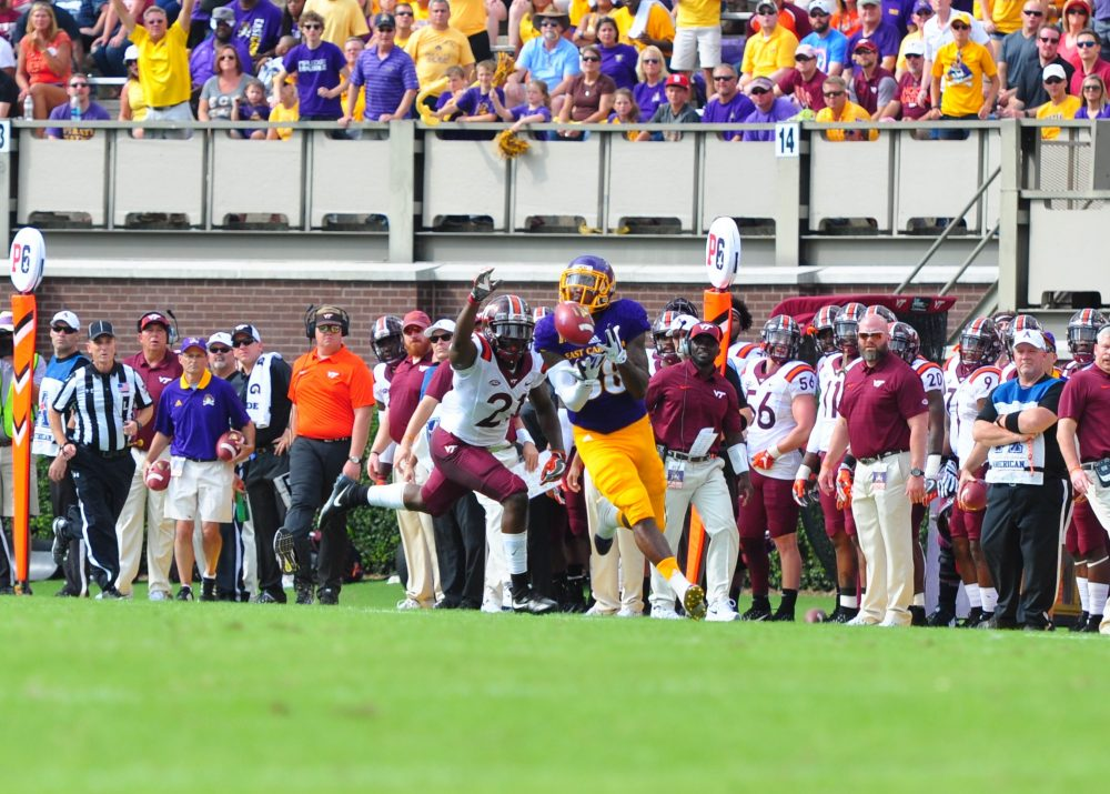 New Hanover product Trevon Brown beats Virginia Tech safety Reggie Floyd over the top for East Carolina's second touchdown. (Photo by Bonesville Staff)