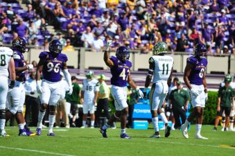 Sophomore defensive back Devon Sutton celebrates after a third down stop for the Pirates in the first half of Saturday's matchup with USF. (Photo by Bonesville Staff)