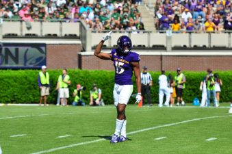 Graduate transfer defensive back Korrin Wiggins asks for some noise from the Dowdy-Ficklen faithful early in a 61-31 loss to nationally ranked South Florida. (Photo by Bonesville Staff)
