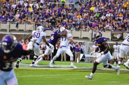 Kiante Anderson puts a big hit on JMU quarterback Bryan Schor, forcing a fumble on the play.