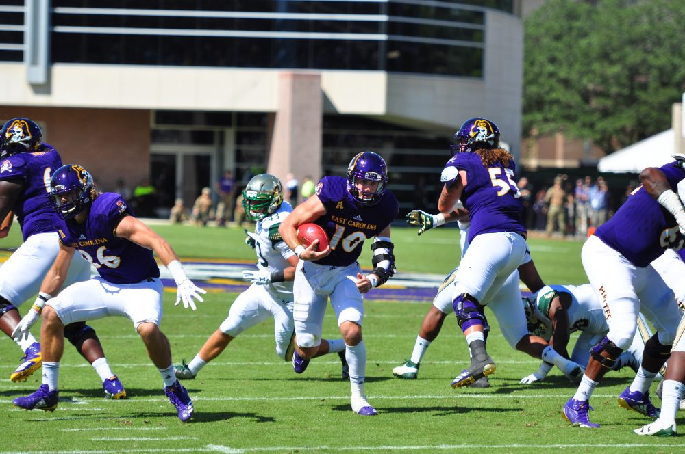 Graduate transfer quarterback Thomas Sirk en route to a 13-yard touchdown run in the second quarter of the ECU's American Athletic Conference opener against USF. (Photo by Bonesville Staff)