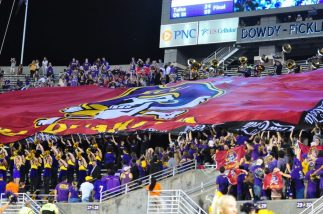 The Dowdy-Ficklen No Quarter tradition received a slight modification in the opening game of the 2017 campaign. Students in the Boneyard unfurled an oversized flag at the outset of the fourth quarter to complement the conventional-size flag raised in the west end zone.