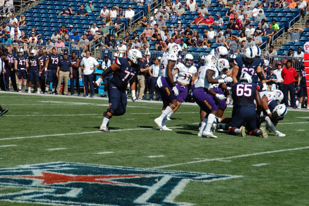 ECU defenders make a third down stop on UConn's first possession. (Photo by Al Myatt)
