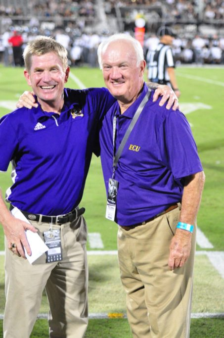Assistant athletic director for major gifts Matt Maloney (left) is pictured with prominent ECU benefactor Ron Dowdy. (Photo by Al Myatt)