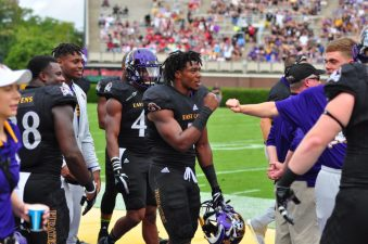 Freshman linebacker Aaron Ramseur, in his first career start, celebrates with teammates after an interception in the first half of Saturday's bout with Temple. (Photo by Bonesville Staff)