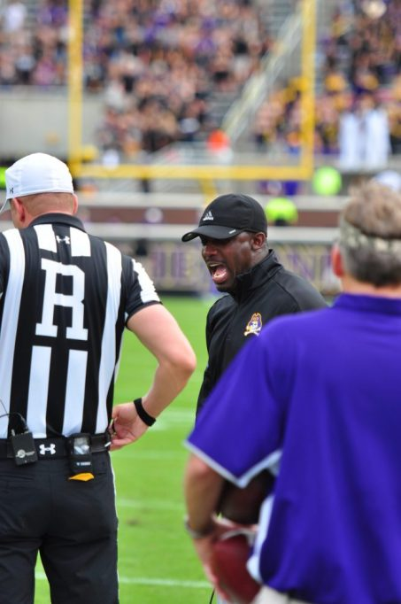 ECU head coach Scottie Montgomery expresses his frustration to referee Todd IaPenta following a questionable no call on a possible late hit on Pirate wide receiver Jimmy Williams in the first half. (Photo by Bonesville Staff)