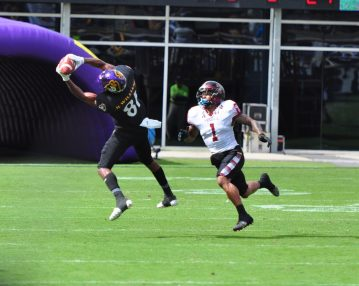 ECU wide receiver Jimmy Williams snags a pass against Temple. The Washington, NC, product was a bright spot on Saturday for the Pirates, tallying 110 yards on five catches. (Photo by Bonesville Staff)
