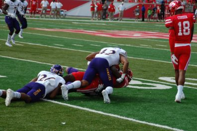 Colby Gore (26) and Devon Sutton (42) combine to stop a Houston receiver for a short gain. (Photo by Al Myatt)
