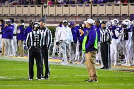 The officials confer on a review of ECU's first score as Pirates coach Scottie Montgomery looks on. (Photo by Al Myatt)