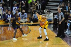 Shockers standout Landry Shamet (right) is matched up against ECU's Isaac Fleming.