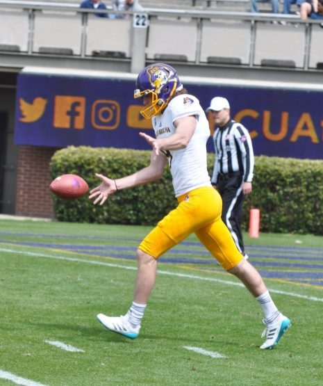 Jake Verity punts for the Gold team, which won Saturday's spring game at Dowdy-Ficklen Stadium, 21-14. (Photo by Al Myatt)
