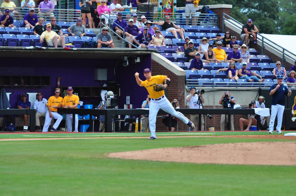 Third baseman Connor Litton fields a softly hit ground ball and fires to first base to record an out in Sunday's contest with UNCW. (Photo by W.A. Myatt)