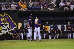 ECU coach Cliff Godwin chats with first baseman Spencer Brickhouse during Saturday night's NCAA regional contest with South Carolina. (Photo by W.A. Myatt)
