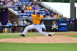 ECU starting pitcher Jake Agnos deals against UNCW. The sophomore left-hander threw three and two thirds innings, allowing two hits and recording six strikeouts before an extended weather delay ended his evening. (Photo by W.A. Myatt)