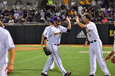 ECU's Friday starter, Chris Holba, celebrates with Ryan Ross, who picked up the win in a 2 and 2 thirds inning relief outing. (Photo by W.A. Myatt)