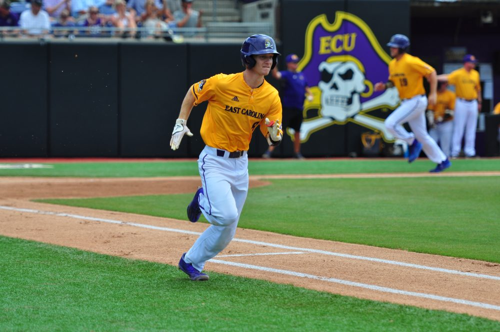 Shortstop Turner Brown runs down the first base line after driving in the Pirates' first run of the game. (Photo by W.A. Myatt)