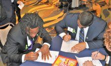 Trevon Brown (left) and Alex Turner answer a questionnaire at the AAC's social media table. (Photo by Al Myatt)